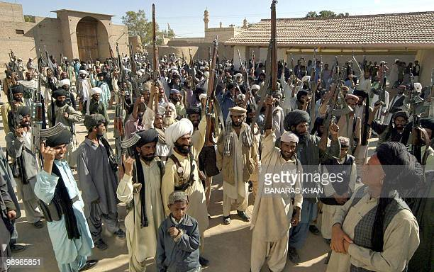 Pakistani Baluch tribesmen raise their weapons as they gather for a Jirga at Dera Bugti in southwest Baluchistan province16 January 2005 Millions of...