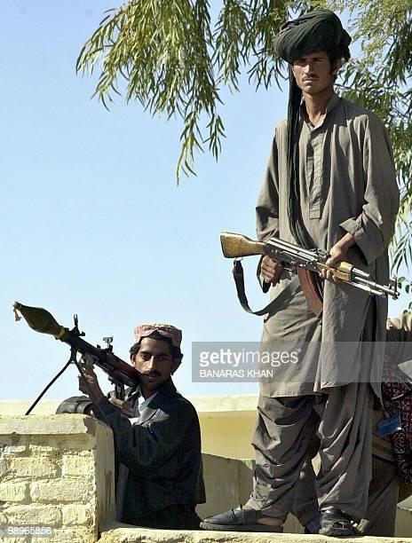 Pakistani Baluch tribesmen stand guard over a Jirga at Dera Bugti in southwest Baluchistan province16 January 2005 Millions of Pakistani households...