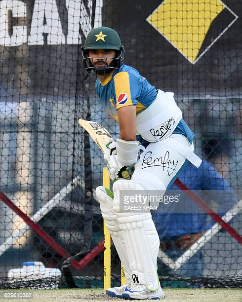 Pakistani batsman Azhar Ali bats during the net practice session at Gabba in Brisbane on December 14 on the eve of a day and night cricket Test match...
