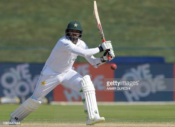 Pakistani batsman Azhar Ali plays a shot during the fourth day of the first Test cricket match between Pakistan and New Zealand at the Sheikh Zayed...