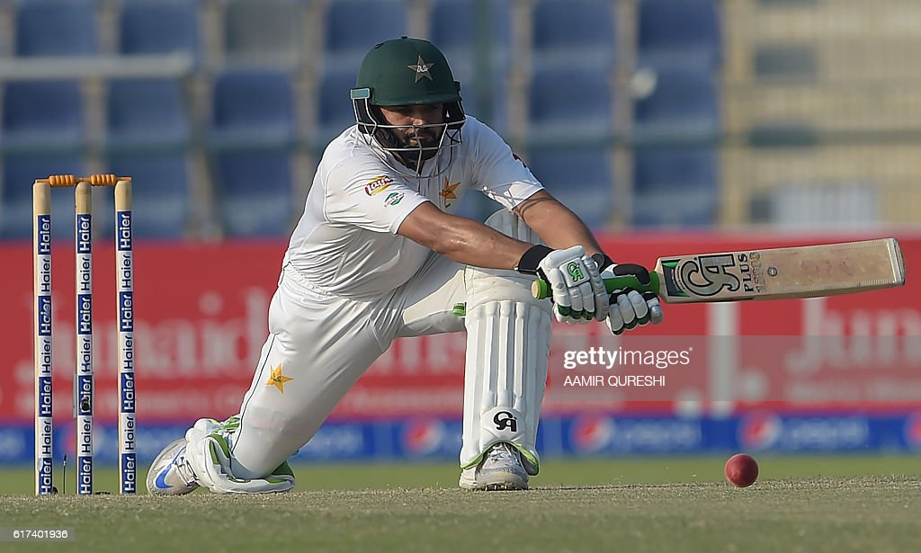 Pakistani batsman Azhar Ali plays a shot on the third day of the second Test between Pakistan and the West Indies at the Sheikh Zayed Cricket Stadium in Abu Dhabi on October 23, 2016. Openers Azhar Ali and Sami Aslam hit half-centuries to help Pakistan strenghten their grip on the third day of the second Test against West Indies in Abu Dhabi. Ali was batting on 52 and Asad Shafiq five not out to take Pakistan to 114-1, having an overall lead of 342 after dismissing West Indies for 224 in their first innings. / AFP / AAMIR
