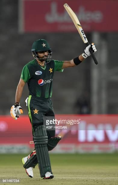 Pakistani batsman Babar Azam celebrates after scoring a half century during the third and final Twenty20 international cricket match between Pakistan...
