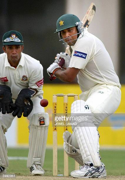 Pakistani batsman InzamamulHaq hits to compele the winning run as Bangladeshi wicketkeeper Khaled Mahsud looks on during the fourth day of the third...