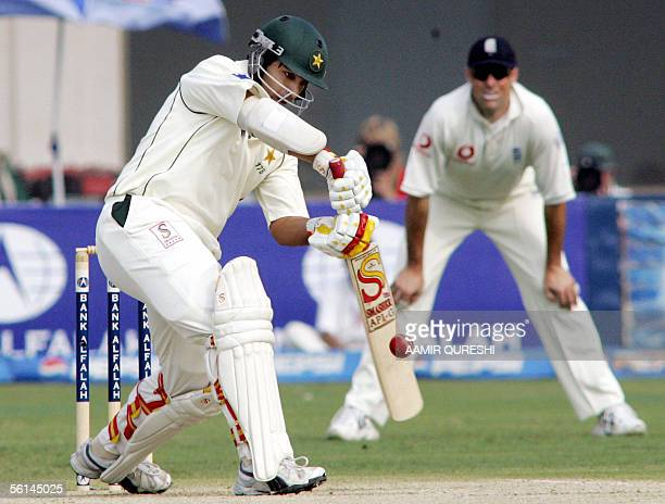 Pakistani batsman Salman Butt hits a boundary as English skipper Marcus Trescothick looks on during the opening day of their first Test match in...