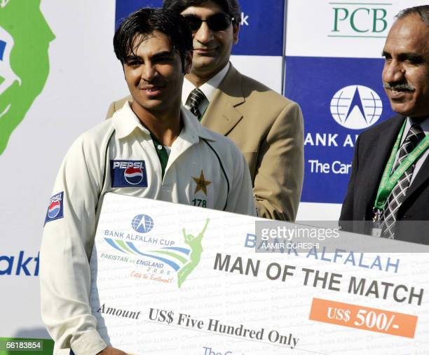 Pakistani batsman Salman Butt receives the man of the match award during the match closing ceremony following Pakistan's victory over England on the...