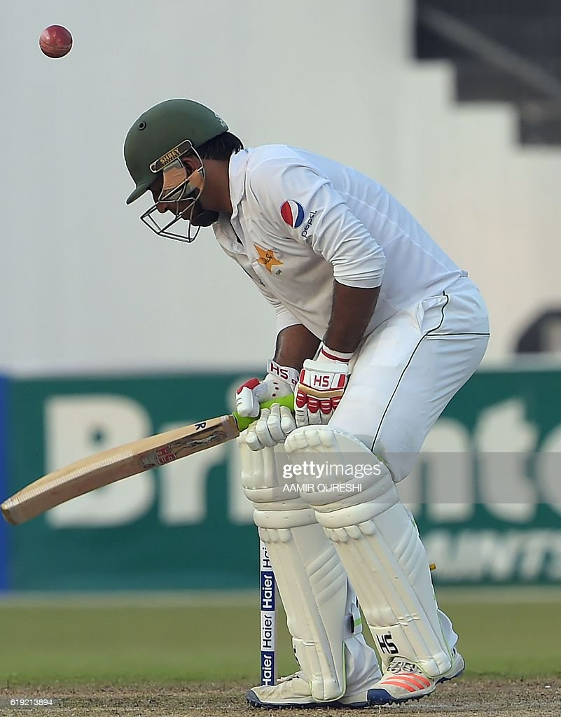 Pakistani batsman Sarfraz Ahmed is bowled out by West Indies' bowler hannon Gabriel unseen on the first day of the third and final Test between Pakistan and West Indies at the Sharjah Cricket Stadium in Sharjah on October 30, 2016. Pakistan captain Misbah-ul-Haq won the toss and opted to bat against West Indies in the third and final Test in Sharjah. / AFP / AAMIR