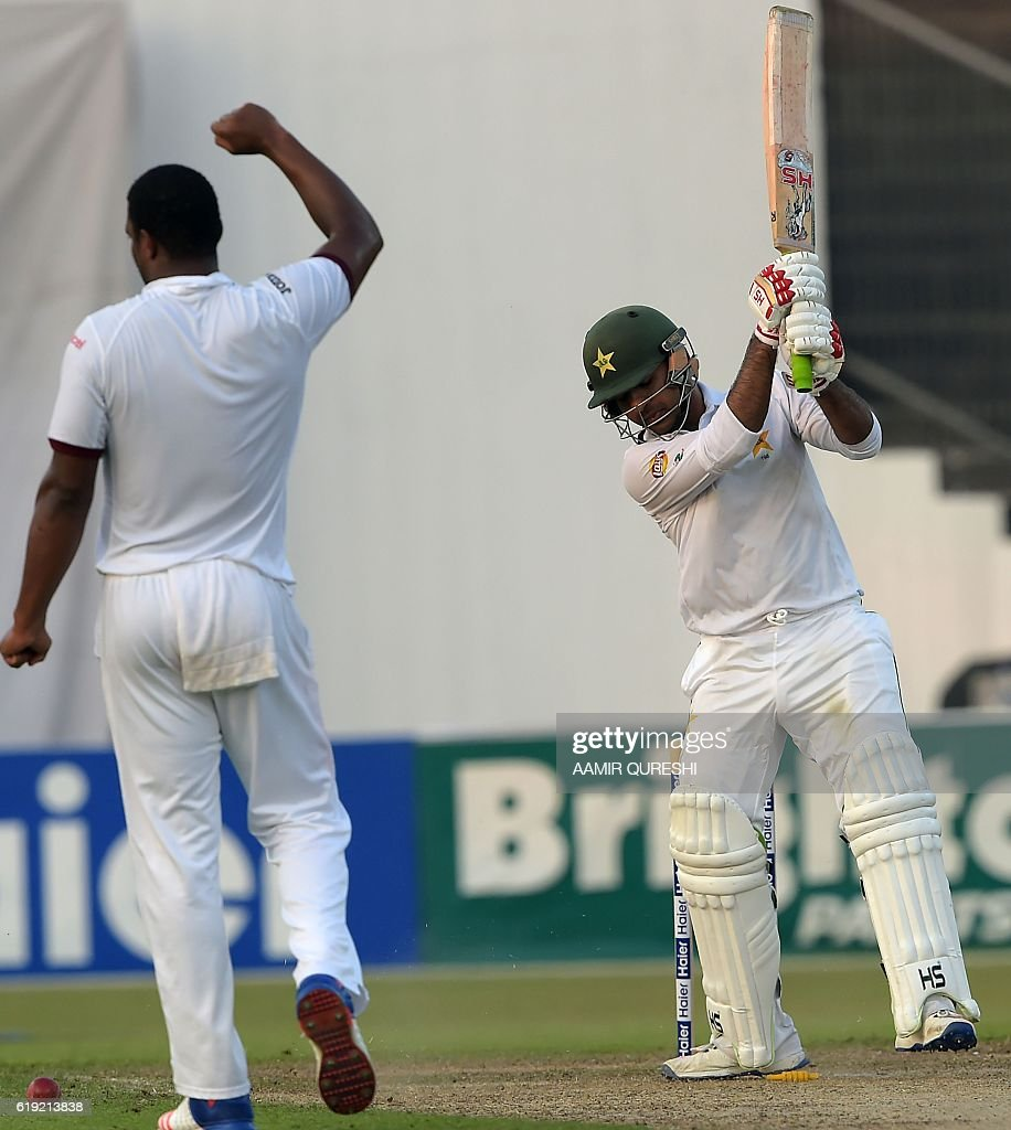 Pakistani batsman Sarfraz Ahmed (R) reacts after his dismissal by West Indies' bowler Shannon Gabriel (L) on the first day of the third and final Test between Pakistan and West Indies at the Sharjah Cricket Stadium in Sharjah on October 30, 2016. Pakistan captain Misbah-ul-Haq won the toss and opted to bat against West Indies in the third and final Test in Sharjah. / AFP / AAMIR