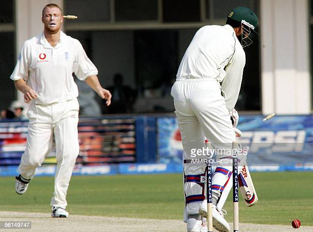 Pakistani batsman Shabbir Ahmed is bowled out by England bowler Andrew Flintoff during the second day of the first Test match in Multan Cricket...