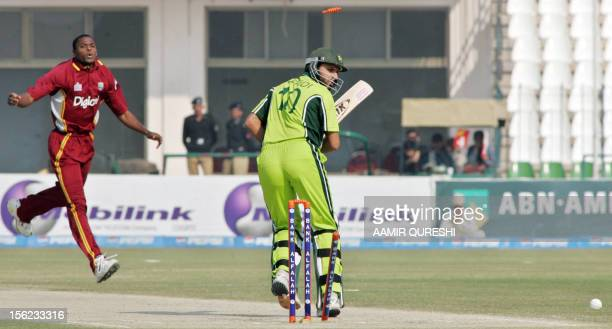 Pakistani batsman Shahid Afridi watches as he is bowled out by West Indies bowler Darren Powell during the 4th One-Day International cricket match...