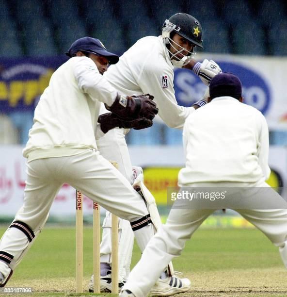 Pakistani batsman Shoaib Malik edges Sri Lankan off spinner Mattiah Muralitharan to slip where Mahela Jayawardene dropped an easy catch on the fourth...