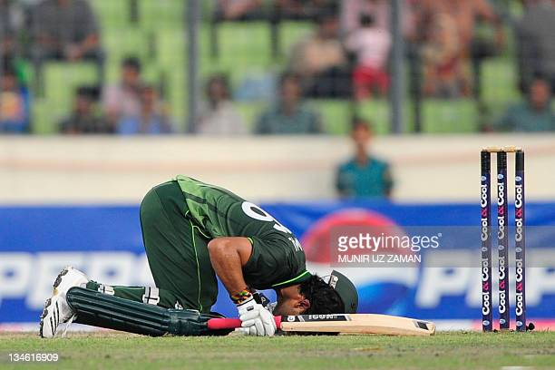Pakistani batsman Umar Akmal bow towards Mecca after scoring a half century during the second one day international cricket match between Bangladesh...