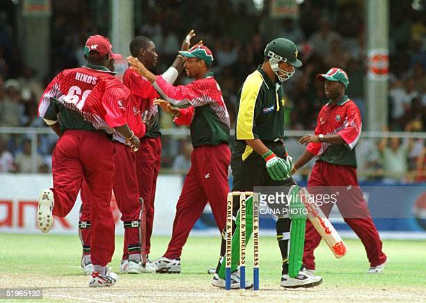 Pakistani batsman Waqar Younis is caught by West Indies wicket keeper Ridley Jacobs 19 April 2000 bowled Chris Gayle at the First Cable amp Wireless...