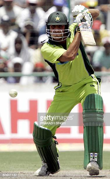Pakistani batsman Younis Khan powers a shot during the final one day international cricket match between India and Pakistan at Feroz Shah Kotla...