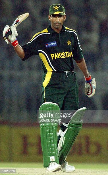 Pakistani batsman Yousuf Youhana rises his bat to acknowledge the crowd after scoring a halfcentury during the fourth One Day International match...
