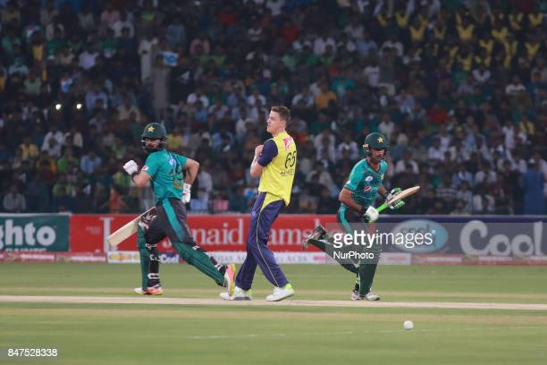 Pakistani batsmen Fakhar Zaman and Ahmed Shahzad run between the wicket during the third and final Twenty20 International match between the World XI...