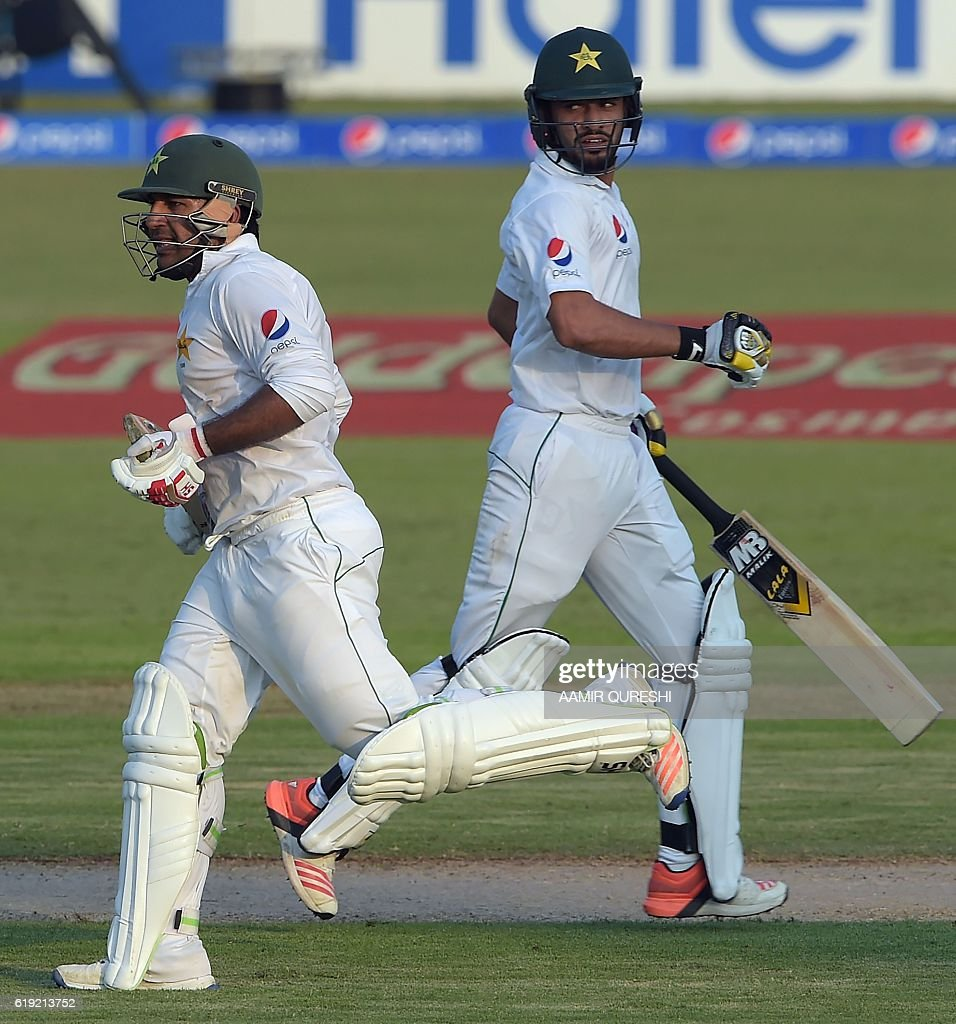 Pakistani batsmen Mohammad Nawaz (R) and Sarfraz Ahmed run between the wicket on the first day of the third and final Test between Pakistan and West Indies at the Sharjah Cricket Stadium in Sharjah on October 30, 2016. Pakistan captain Misbah-ul-Haq won the toss and opted to bat against West Indies in the third and final Test in Sharjah. / AFP / AAMIR