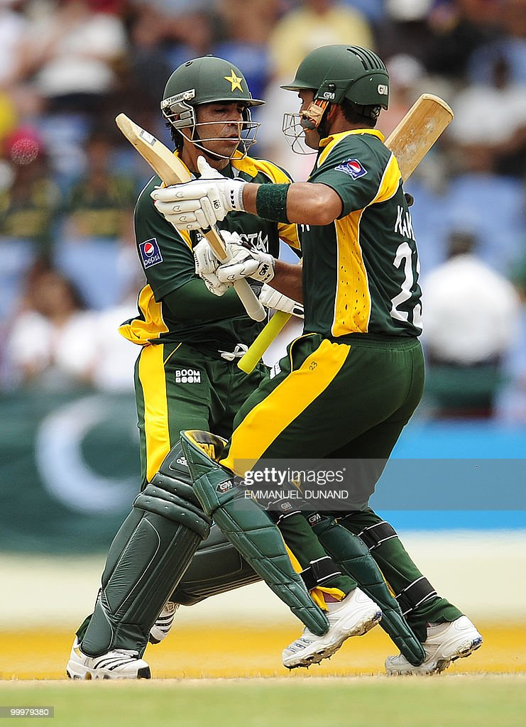 Pakistani batsmen Salaman Butt (L) and Kamran Akmal nearly collide as they score a run during the ICC World Twenty20 second semifinal match between Australia and Pakistan at the Beausejour Cricket Ground on May 14, 2010 in Gros Islet, St Lucia. AFP PHOTO/Emmanuel Dunand