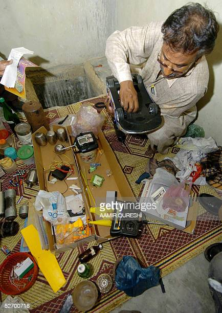 Pakistani bomb disposal expert examines a toy car after a raid by police on a house in Karachi 27 April 2005 Pakistani police arrested two militants...