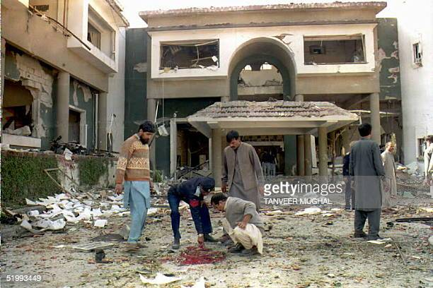 Pakistani bomb squad examines the site of a bomb attack 19 November at the Egyptian embassy in Islamabad. Fifteen people were killed and scores were...
