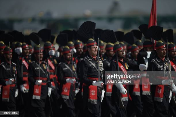 Pakistani border soldiers march past during the Pakistan Day military parade in Islamabad on March 23 2018 Pakistan National Day commemorates the...