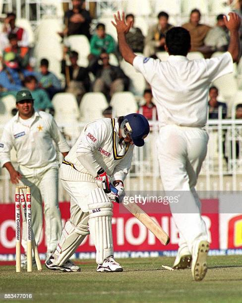 Pakistani bowler Abdur Razzak celebrates the dismissal of Sri Lankan batsman Arjuna Ranatunga on the second day of the first cricket Test at...