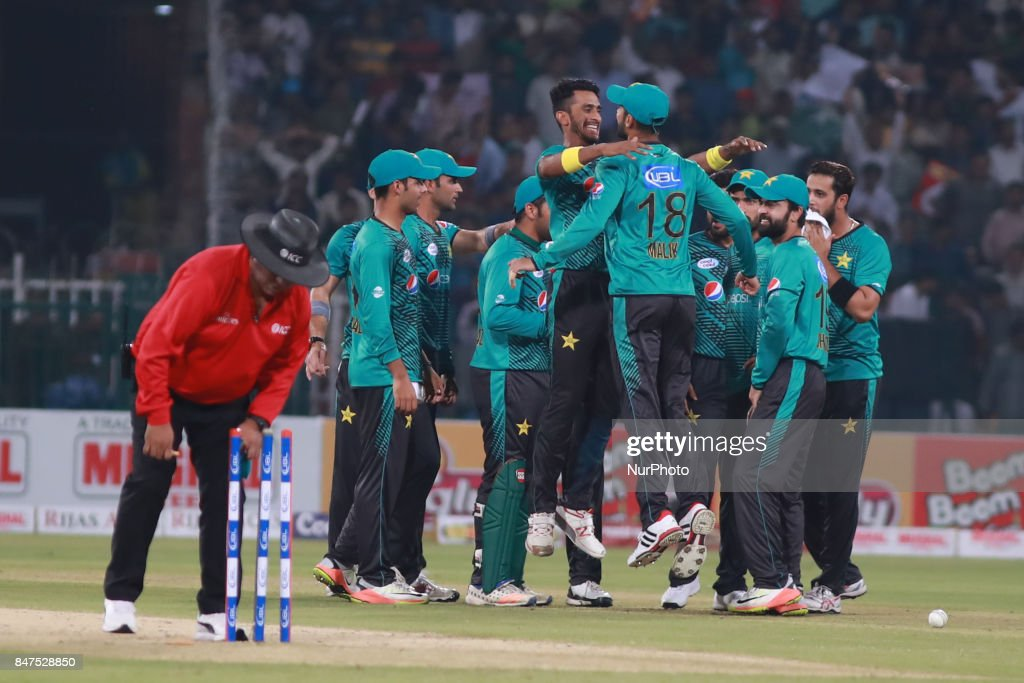Pakistani bowler Hassan Ali celebrates with team mates after taking the wicket of World XI batsman Ben Cutting during the third and final Twenty20...