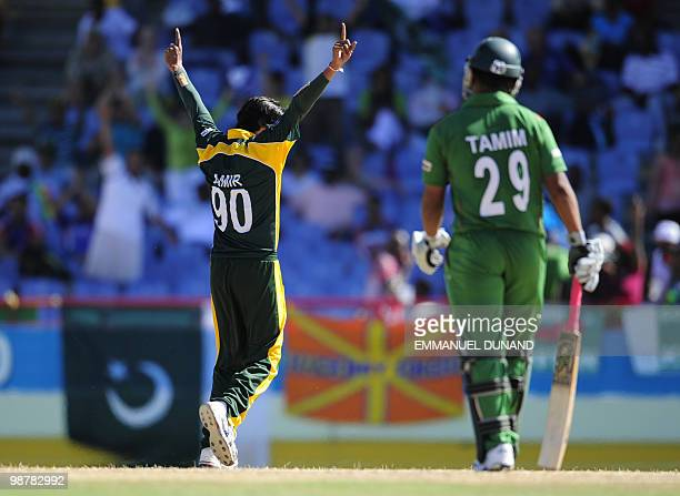 Pakistani bowler Mohammad Aamer celebrates after taking the wicket of Bangladeshi batsman Imrul Kayes as Tamim Iqbal looks during the match Pakistan...