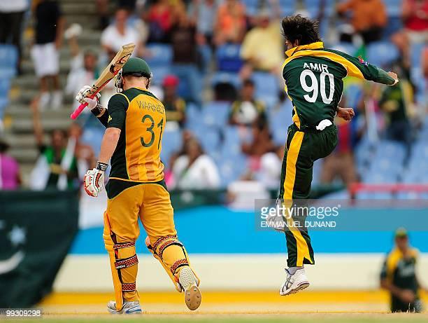 Pakistani bowler Mohammad Aamer celebrates after taking the wicket of Australian batsman David Warner during the ICC World Twenty20 second semifinal...