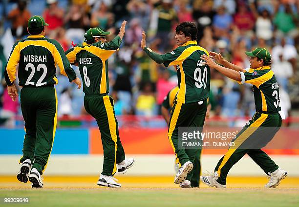 Pakistani bowler Mohammad Aamer celebrates with teammates after taking the wicket of Australian batsman Shane Watson during the ICC World Twenty20...