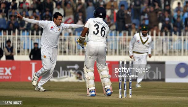 Pakistani bowler Mohammad Abbas celebrates the dismissal of Sri Lankan batsman Dinesh Chandimal during the first day of the play of 1st Test cricket...