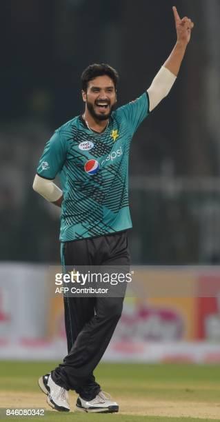 Pakistani bowler Rumman Raees celebrates after taking the wicket of World XI batsman Tamim Iqbal during the first Twenty20 international cricket...