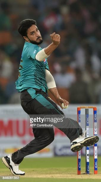Pakistani bowler Rumman Raees delivers the ball during the first Twenty20 international cricket match between the World XI and Pakistan at The...