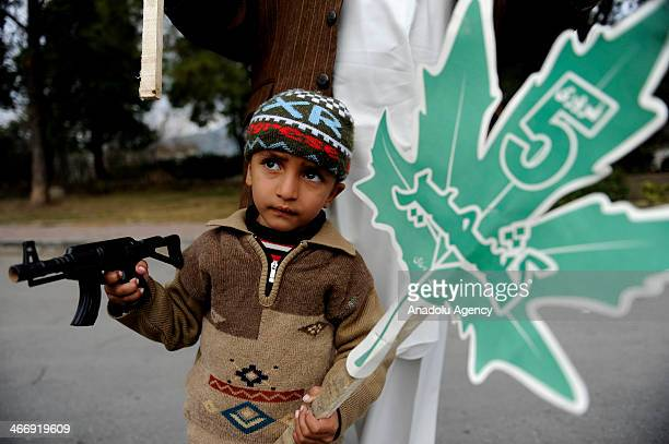 Pakistani boy holds a banner during the commemoration of Kashmir Solidarity day in Pakistan on February 5 for each year in Islamabad Pakistan on...