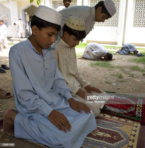 Pakistani boys pray at a local mosque during Friday prayers July 13 in Islamabad Pakistan Government reports indicate that 1 policeman 10 soldiers...