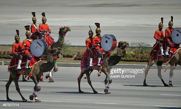 A Pakistani camelmounted military band performs during the Pakistan Day military parade in Islamabad on March 23 2015 Pakistan held its first...