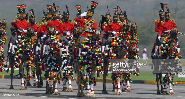 Pakistani CamelMounted Paramilitary Rangers play national tunes as they ride on their camels during a military parade to mark Pakistan's National Day...