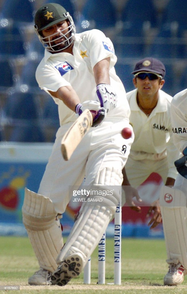 Pakistani captain Inzamam-ul Haq (L) hits a boundary off Indian spin bowler Anil Kumble (not in picture) during the third day of the first Test match between Pakistan and India in Multan, 30 March 2004. Chasing India's first inning's 675 runs, Pakistan made 252 runs for the loss of four wickets at tea break. AFP PHOTO/Jewel SAMAD