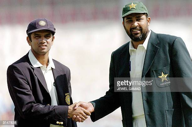 Pakistani captain Inzamam-ul Haq shakes hands with his Indian counterpart Rahul Dravid before the start of the first day of the first Test match...