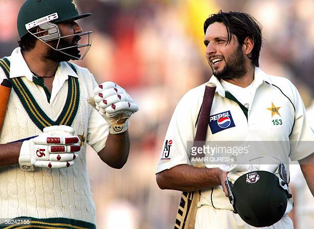 Pakistani captain InzamamulHaq and teammate Shahid Affridi walk back to the pavillion at the end of play on the first day of the second Test match at...