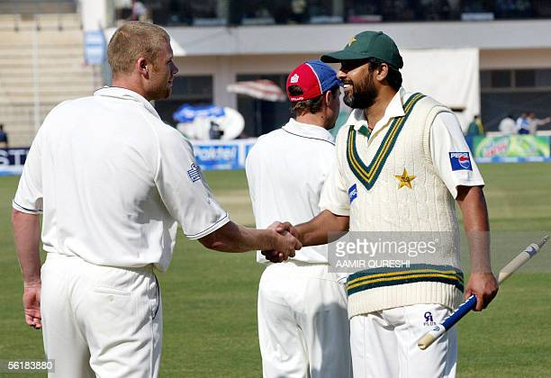 Pakistani captain InzamamulHaq shakes hands with England cricketer Andrew Flintoff following Pakistan's victory over England on the last day of the...