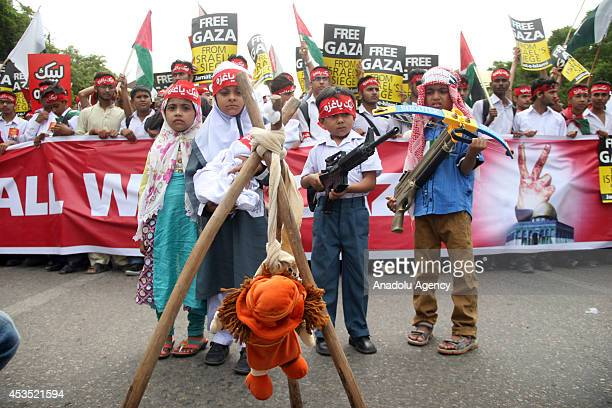 Pakistani children hold toy weapons during a demonstration organised by the Pakistani religious party JamaateIslami against Israeli military action...