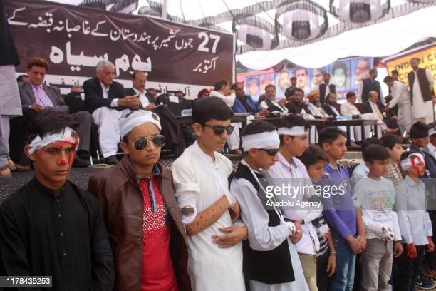 Pakistani children take part in a rally during a demonstration to mark Black Day in Muzaffarabad the capital of Pakistanadministered territory of...