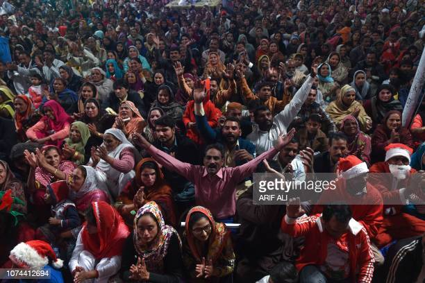 TOPSHOT Pakistani Christian attend the candle light Carol service during the Christmas celebration in Lahore Pakistan on December 19 2018