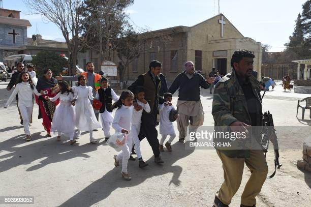 Pakistani Christian children are evacuated by security personnel from a Methodist church after a suicide bomber attack during a Sunday service in...