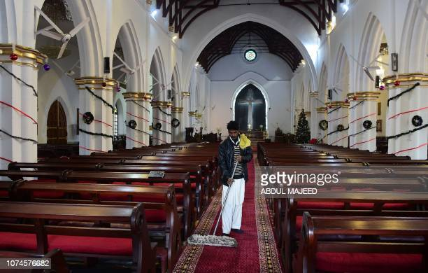 A Pakistani Christian cleans the St John's Church ahead of Christmas celebrations in Peshawar on December 22 2018
