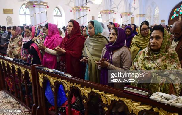 Pakistani Christian devotees attend a special service ahead of Christmas at the St John's Church in Peshawar on December 23 2018