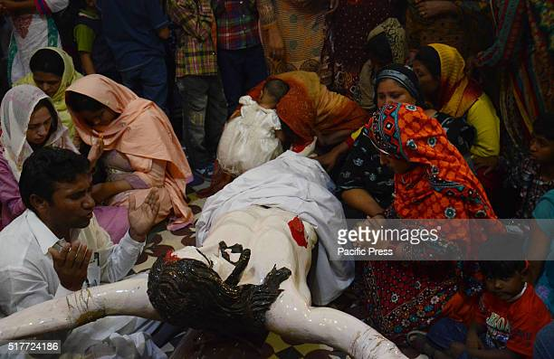 Pakistani Christian devotees attend the mass to mark Good Friday in a church in Lahore Christians around the world are marking Good Friday ahead of...