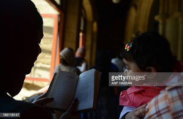 Pakistani Christian family attend an Easter Mass at a church in Karachi on March 31, 2013. Pakistan is overwhelmingly Muslim and at around two...