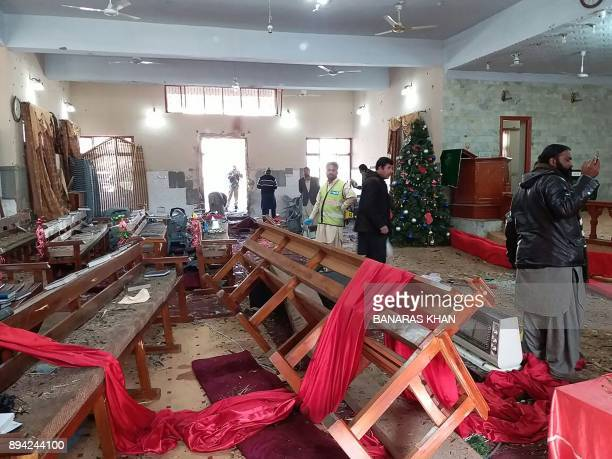 Pakistani Christian gather in the Methodist church after suicide bombers attack during a Sunday service in Quetta on December 17 2017 At least eight...