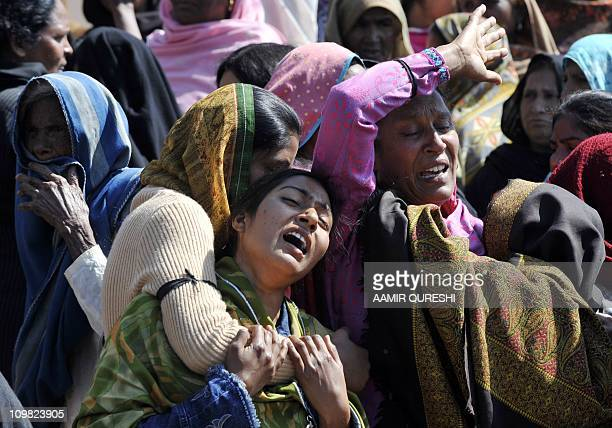 Pakistani Christian mourn the killing of slain Pakistani minister for minorities Shahbaz Bhatti during the funeral ceremony in his native village...